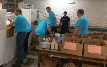 Armstrong employees volunteering at local food bank